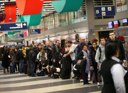 Travelers wait in line to check-in for flights at O'Hare International Airport on December 20, 2013 in Chicago, Illinois. More than 200,000 passengers are expected to travel through O'Hare today for the start of the Christmas holiday period. (Photo by Scott Olson/Getty Images)