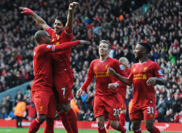 Luis Suarez of Liverpool celebrates his second goal against Cardiff City at Anfield on December 21, 2013 in Liverpool, England.