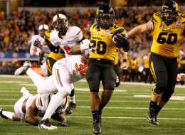 Running back Henry Josey #20 of the Missouri Tigers scores on a 20-yard touchdown run in the fourth quarter against the Oklahoma State Cowboys during the AT&T Cotton Bowl on January 3, 2014 in Arlington, Texas.  (Photo by Ronald Martinez/Getty Images)