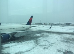 A plane from Toronto landed safely at John F. Kennedy International Airport on Sunday before sliding into snow as it turned onto a taxiway. The airport temporarily suspended flights from taking off and landing because of icy runways. (Laurie Kopec/ Twitter)