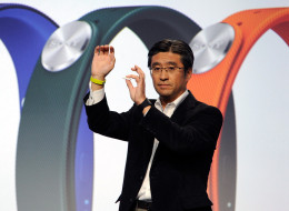 LAS VEGAS, NV - JANUARY 06:  Sony Executive Vice President of Sony Corporation and Sony Mobile Communications President and CEO Kunimasa Suzuki displays a Sony SmartBand and Core during a Sony press event at the Las Vegas Convention Center for the 2014 International CES on January 6, 2014 in Las Vegas, Nevada. CES, the world's largest annual consumer technology trade show, runs from January 7-10 and is expected to feature 3,200 exhibitors showing off their latest products and services to about 1