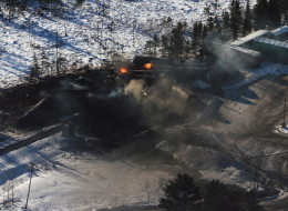 Derailed train cars burn in Plaster Rock, N.B. on Jan. 8. A CN freight train carrying crude oil and propane derailed Tuesday night in a sparsely populated region of northwestern New Brunswick.