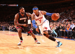 Carmelo Anthony #7 of the New York Knicks drives against LeBron James #6 of the Miami Heat during a game at Madison Square Garden in New York City on January 9, 2014.  NOTE TO USER: User expressly acknowledges and agrees that, by downloading and or using this photograph, User is consenting to the terms and conditions of the Getty Images License Agreement. Mandatory Copyright Notice: Copyright 2014 NBAE  (Photo by Nathaniel S. Butler/NBAE via Getty Images)
