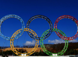 The Olympic Rings stand outside of Sochi International Airport on January 8, 2014 in Alder, Russia. The region will host the Sochi 2014 Winter Olympics which start on February 6th, 2014.  (Photo by Michael Heiman/Getty Images)