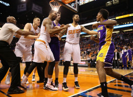 Marcus Morris #15 and Markieff Morris #11 of the Phoenix Suns push Nick Young #0 of the Los Angeles Lakers after he reacted to Alex Len #21 (second from left) for a flagrant foul during the first half of the NBA game at US Airways Center on January 15, 2014 in Phoenix, Arizona.  NOTE TO USER: User expressly acknowledges and agrees that, by downloading and or using this photograph, User is consenting to the terms and conditions of the Getty Images License Agreement.