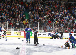 A line brawl between the Vancouver Canucks and the Calgary Flames broke out at the start of  their NHL game at Rogers Arena January 18, 2014 in Vancouver, British Columbia, Canada.  (Photo by Jeff Vinnick/NHLI via Getty Images)