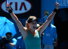 Canada's Eugenie Bouchard celebrates after victory in her women's singles match against Serbia's Ana Ivanovic on day nine at the 2014 Australian Open tennis tournament in Melbourne on January 21. (WILLIAM WEST/AFP/Getty Images)