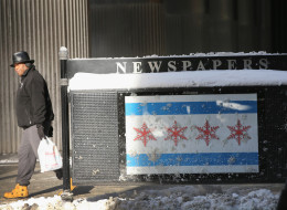 A Chicago flag with snowflakes instead of stars is displayed on the back of a newspaper vending box as temperatures dipped well below zero in the Loop on January 6, 2014 in Chicago, Illinois. (Photo by Scott Olson/Getty Images)