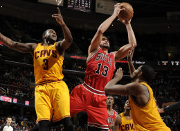 Joakim Noah #13 of the Chicago Bulls pulls down the rebound against Dion Waiters #3 and Tristan Thompson #13 of the Cleveland Cavaliers at The Quicken Loans Arena on January 22, 2014 in Cleveland, Ohio. (Photo by David Liam Kyle/NBAE via Getty Images)