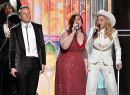 LOS ANGELES, CA - JANUARY 26:  (L-R) Rapper Macklemore, singer Mary Lambert and singer Madonna perform onstage during the 56th GRAMMY Awards at Staples Center on January 26, 2014 in Los Angeles, California.  (Photo by Kevin Winter/WireImage)