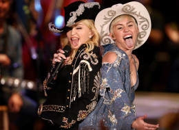 HOLLYWOOD, CA - JANUARY 28:  Madonna and Miley Cyrus perform onstage during Miley Cyrus: MTV Unplugged at Sunset Gower Studios on January 28, 2014 in Hollywood, California. Miley Cyrus: MTV Unplugged premieres on January 29, 2014 on MTV at 9/8 PM. (Photo by Christopher Polk/Getty Images for MTV)