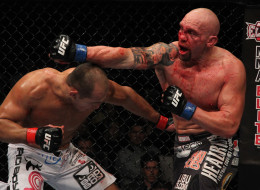 Shane Carwin punches Junior Dos Santos during a heavyweight bout at UFC 131 at Rogers Arena on June 11, 2011 in Vancouver. UFC is returning to Vancouver on June 14.