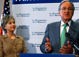 WASHINGTON - SEPTEMBER 10:  Senate Agriculture Chairman Tom Harkin (D-IA) (R) and U.S. Sen. Hillary Clinton (D-NY) talk about fair pay for women during a news conference on Capitol Hill September 10, 2008 in Washington, DC. Clinton joined Harkin to unveil a Government Accountability Office report on how the Bush Administration is addressing pay inequities in the private and public sectors.  (Photo by Mark Wilson/Getty Images)