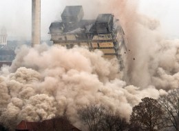 A university tower collapses during the blasting of the 116 meters building in Frankfurt am Main, western Germany, on February 2, 2014. The so-called AfE high-rise building was part of Frankfurt's university campus and was used by students of educational science until March 2013. AFP PHOTO / DPA / BORIS ROESSLER / GERMANY OUT        (Photo credit should read BORIS ROESSLER/AFP/Getty Images)