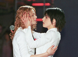 Lena Katina and Yulia Volkova from TATU  during a concert, 3 October 2002 in Lodz, Poland. The Russian duo TATU are coming to the UK for a series of concerts in London and Manchester in May 2003. (Photo by East News/Getty Images)