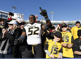 Michael Sam #52 of the Missouri Tigers celebrates with fans after the game against the Kentucky Wildcats at Commonwealth Stadium on November 9, 2013 in Lexington, Kentucky.