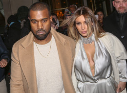 Kanye West has denied claims he cheated on Kim Kardashian. Here, the two leave the 'Meurice' hotel on Jan. 21 in Paris. (Marc Piasecki/FilmMagic)