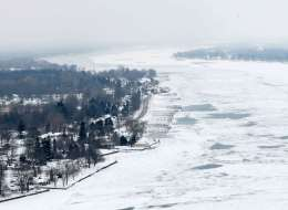 In this Feb. 6, 2014 aerial photo is the ice covered St. Clair River with the Canadian shoreline on the left. The Great Lakes were 88 per cent frozen this week, the most they've been in 20 years.