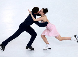 SOCHI, RUSSIA - FEBRUARY 17:  Tessa Virtue and Scott Moir of Canada compete in the Figure Skating Ice Dance Free Dance on Day 10 of the Sochi 2014 Winter Olympics at Iceberg Skating Palace on February 17, 2014 in Sochi, .  (Photo by Clive Mason/Getty Images)
