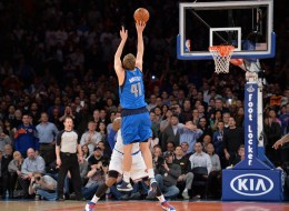 Dirk Nowitzki of the Dallas Mavericks shoots the winning shot over Carmelo Anthony of the New York Knicks during their NBA game February 24, 2014 at Madison Square Garden in New York. The Mavericks won, 110-108. AFP PHOTO/Stan HONDA        (Photo credit should read STAN HONDA/AFP/Getty Images)