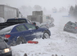 Damaged vehicles are shown after a multi-vehicle pileup on Highway 400 near Innisfil, Ont., Thursday, Feb.27, 2014.