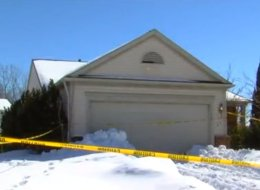 The body of a woman whom neighbors say they last saw several years ago was found in a sport utility vehicle parked in the garage of a foreclosed home northwest of Detroit.