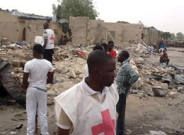 Red Cross officials search on March 2, 2014 for the bodies of the victims and the wounded at the scene where two explosions rocked a crowded neigbourhood in Maiduguri's Gomaris district on the evening of March 1. (STRINGER/AFP/Getty Images)