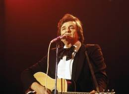 UNITED KINGDOM - JANUARY 01:  Photo of Johnny CASH; Johnny Cash performing on stage at the Country Music Festival,  (Photo by David Redfern/Redferns)