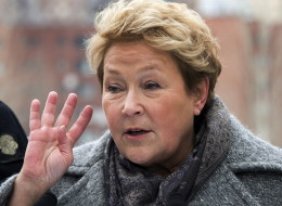 Parti Quebecois leader Pauline Marois speaks to the media as while campaigning Saturday, March 29, 2014 in Montreal, Que.. Quebecers will vote in a provincial election April 7, 2014. (THE CANADIAN PRESS/Ryan Remiorz)