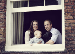 Right as reign! It's a family affair for Prince George, who poses next to his proud parents, Prince William and Kate Middleton, at their Kensington Palace residence, in this new photo, released just in time for UK Mother's Day March 30. (Handout)