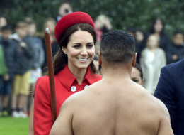 Britain's Kate, the Duchess of Cambridge, chats with a Maori warrior at the official welcome for her and her husband Prince William, at Government House, in Wellington, New Zealand, Monday, April 7, 2014. (AP Photo/SNPA, Ross Setford) NEW ZEALAND OUT