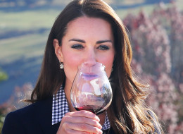 Catherine Duchess of Cambridge samples red wine as the visit Otago Wines at Amisfield winery on April 13, 2014 in Queenstown, New Zealand. The Duke and Duchess of Cambridge are on a three-week tour of Australia and New Zealand, the first official trip overseas with their son, Prince George of Cambridge.  (Photo by Pool/Samir Hussein/WireImage)
