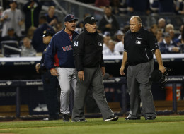 John Farrell #53 of the Boston Red Sox reacts after being ejected by umpire Bob Davidson #61 arguing a call settled by instant replay during a game against the New York Yankees at Yankee Stadium on April 13, 2014 in the Bronx Borough of New York City.  Home plate umpire Brian O'Nora looks on. (Photo by Jeff Zelevansky/Getty Images)