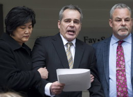 Douglas de Grood, centre, is supported by wife Susan, left, and lawyer Allan Fay after reading a statement in Calgary, Alberta on Thursday, April 17, 2014. De Grood's son Mathew is charged with killing five young people in Calgary. (THE CANADIAN PRESS/Larry MacDougal)
