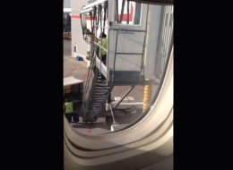 An Air Canada passenger filmed footage of a baggage handler tossing passengers' luggage into a big several meters below.