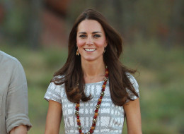 Catherine, Duchess of Cambridge walks down Kuniya Walk at the base of Uluru on April 22, 2014 in Ayers Rock, Australia. The Duke and Duchess of Cambridge are on a three-week tour of Australia and New Zealand, the first official trip overseas with their son, Prince George of Cambridge.  (Photo by Scott Barbour/Getty Images)