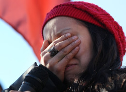 Destiny Phillips gets emotional after speaking as Idle No More protesters rally at the base of the Ambassador Bridge between Windsor and the United States on Jan. 16, 2013. A report has found that indigenous people in Toronto are dying much sooner than Canadian citizens.