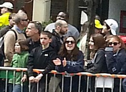 BOSTON, MA - APRIL 15:  This cell phone image, taken in front of the Forum Restaurant, appears to show Boston Marathon bombing suspect #2, Dzhokhar A. Tsarnaev, near a young boy who is standing on the railing and thought to be eight-year-old victim Martin Richard on Boylston Street April 15, 2013 in Boston, Massachusetts. There is a backpack on the ground behind Martin Richard and his family, presumably left by Dzhokhar A. Tsarnaev, seen in the white hat in the image, that may contain the second