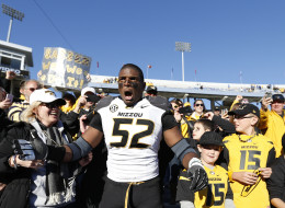 Michael Sam #52 of the Missouri Tigers celebrates with fans after the game against the Kentucky Wildcats at Commonwealth Stadium on November 9, 2013 in Lexington, Kentucky. Missouri won 48-17. (Photo by Joe Robbins/Getty Images)