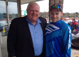 Toronto Mayor Rob Ford poses for a photo with Brody Lisle in Bracebridge, Ont., on Friday, May 16, 2014. Rob Ford is still in rehab, his lawyer said Friday as photos of the mayor posing with residents in Ontario's cottage country were posted online. Dennis Morris wouldn't, however, confirm whether his client is in Bracebridge, a town in the Muskoka region. THE CANADIAN PRESS/Brody Lisle