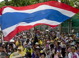 Thai anti-government protesters wave national flags as they rally at Parliament in Bangkok on May 16, 2014. (PORNCHAI KITTIWONGSAKUL/AFP/Getty Images)