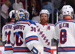 Henrik Lundqvist #30, Derek Stepan #21 Brad Richards #19 and Kevin Klein #8 of the New York Rangers celebrate the victory over the Montreal Canadiens  in Game Two of the Eastern Conference Final during the 2014 NHL Stanley Cup Playoffs at the Bell Centre on May 19, 2014 in Montreal, Quebec, Canada. (Photo by Francois Lacasse/NHLI via Getty Images)