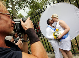 Da'onna Johnson (L) and Amanda Johnson from Pennsylvania kiss after marrying in New York. (Photo by Mario Tama/Getty Images)