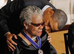 U.S. President Barack Obama (R) kisses poet and author Maya Angelou after giving her the 2010 Medal of Freedom in the East Room of the White House February 15, 2011 in Washington, DC. Obama presented the medal to twelve pioneers in sports, labor, politics and arts. (Photo by Chip Somodevilla/Getty Images)