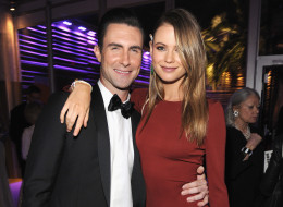 Behati Prinsloo and Adam Levine attend the 2014 Vanity Fair Oscar Party Hosted By Graydon Carter on March 2, 2014 in West Hollywood, California.  (Photo by Kevin Mazur/VF14/WireImage)