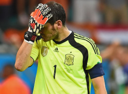 Iker Casillas of Spain reacts after allowing the Netherlands' fourth goal during the 2014 FIFA World Cup Brazil Group B match on June 13, 2014 in Salvador, Brazil.