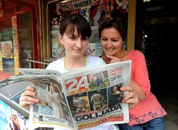 Two saleswoman in front of local store view the daily newspaper '24 Sata' (24 Hours) showing photos of several Croatia's players naked by their swimming pool in Brazil, at a bar in downtown Zagreb, Croatia, on June 16, 2014. Croatia international striker Ivica Olic slammed local media for the 'shameful' publishing of photographs which showed teammates swimming naked at their World Cup base in Brazil, a local paper reported on June 16. Publishing of the photos sparked outrage from the players who