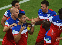 Clint Dempsey of the United States celebrates with teammates after scoring his team's first goal during the 2014 FIFA World Cup Brazil Group G match between Ghana and the United States at Estadio das Dunas on June 16, 2014 in Natal, Brazil.  (Photo by Laurence Griffiths/Getty Images)