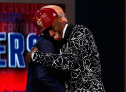 Andrew Wiggins (R) of Kansas embraces NBA Commissioner Adam Silver after Wiggins was drafted #1 overall in the first round by the Cleveland Cavaliers during the 2014 NBA Draft at Barclays Center on June 26, 2014 in the Brooklyn borough of New York City. NOTE TO USER: User expressly acknowledges and agrees that, by downloading and/or using this Photograph, user is consenting to the terms and conditions of the Getty Images License Agreement.  (Photo by Mike Stobe/Getty Images)