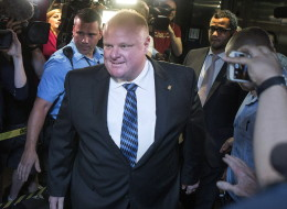 Toronto Mayor Rob Ford is greeted by a media throng as returns to his office at city hall in Toronto on Monday June 30, 2014, after his stay in a rehabilitation facility. THE CANADIAN PRESS/Chris Young